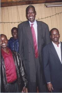 Manute Bol, center, Ayuel Deng far left, Beny Chol, right